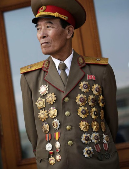 North Korean war veteran Kim Jae Pung, 78, a retired general, is decorated with medals as he attends a parade to celebrate the anniversary of the Korean War armistice agreement, Sunday, July 27, 2014, in Pyongyang, North Korea. North Koreans gathered at Kim Il Sung Square as part of celebrations for the 61st anniversary of the armistice that ended the Korean War. (AP Photo/Wong Maye-E)