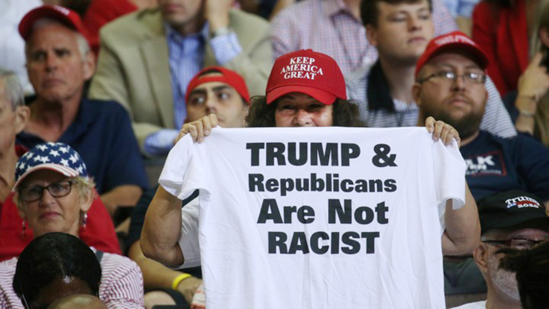 A supporter reacts by showing a t-shirt as U.S. President Donald Trump speaks during a campaign rally in Cincinnati